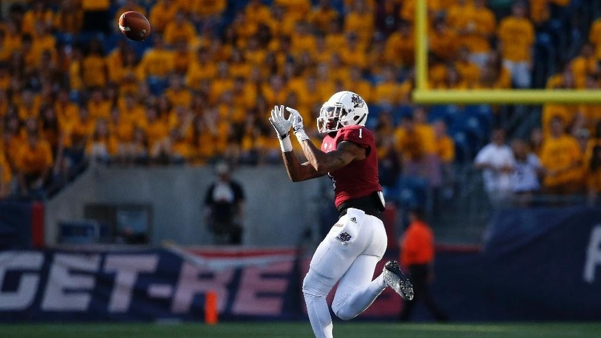 Massachusetts wide receiver Tajae Sharpe (1) gets the touchdown pass during the third quarter of an NCAA college football game against Boston College in Foxborough, Mass., Saturday, Aug. 30, 2014. Boston College won 30-7. (AP Photo/Michael Dwyer)