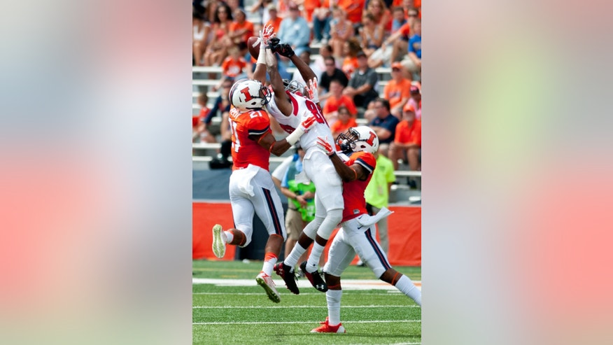 Youngstown State wide receiver Andrew Williams (80) has a pass broken up by Illinois defensive backs Zane Petty (21) and Eaton Spence (27) during the second quarter of an NCAA college football game, Saturday, Aug. 30, 2014 at Memorial Stadium in Champaign, Ill. (AP Photo/Bradley Leeb)