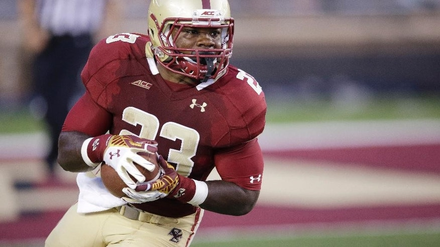 Boston College running back Myles Willis (23) returns a kick during during the first quarter of an NCAA college football game against Pittsburgh, Friday, Sept. 5, 2014, in Boston. (AP Photo/Stephan Savoia)