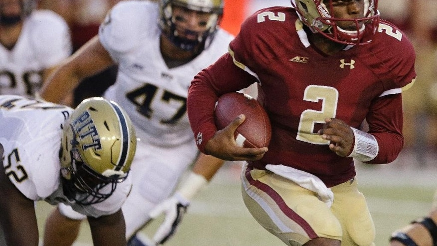 Boston College quarterback Tyler Murphy (2) pulls away from Pittsburgh defenders during the first quarter of an NCAA college football game  Friday, Sept. 5, 2014, in Boston. (AP Photo/Stephan Savoia)