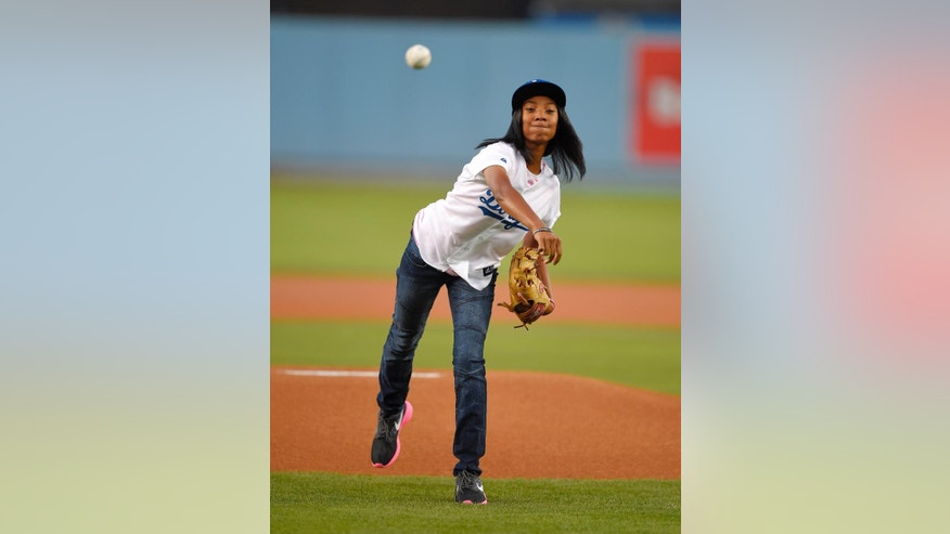 Little League pitcher Mo'ne Davis throws out the ceremonial first pitch prior to a baseball game between the Los Angeles Dodgers and the Washington Nationals, Tuesday, Sept. 2, 2014, in Los Angeles. (AP Photo/Mark J. Terrill)