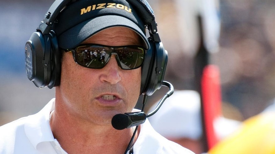 Missouri head coach Gary Pinkel talks to an official during the first quarter of an NCAA college football game against South Dakota State Saturday, Aug. 30, 2014, in Columbia, Mo. (AP Photo/L.G. Patterson)