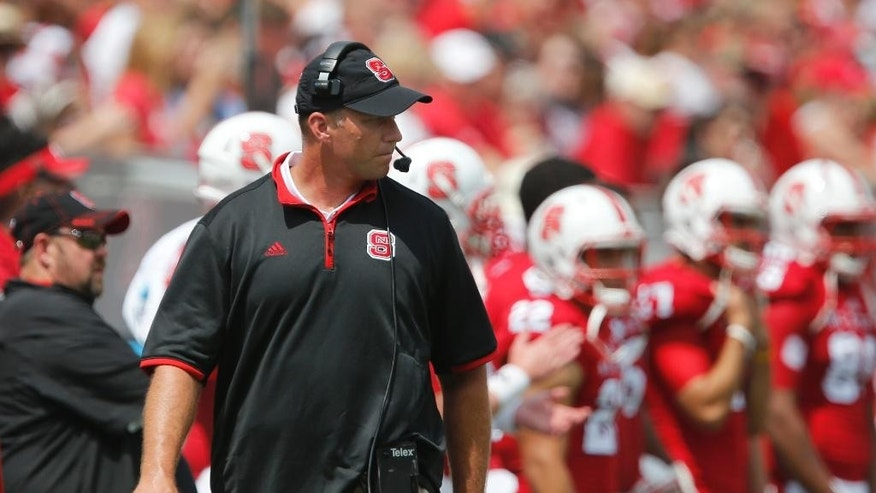 North Carolina State head coach Dave Doeren watches from the sidelines during the first half of an NCAA college football game against Georgia Southern, Saturday, Aug. 30, 2014, in Raleigh, N.C. N.C. State won 24-23. (AP Photo/The News & Observer, Ethan Hyman)