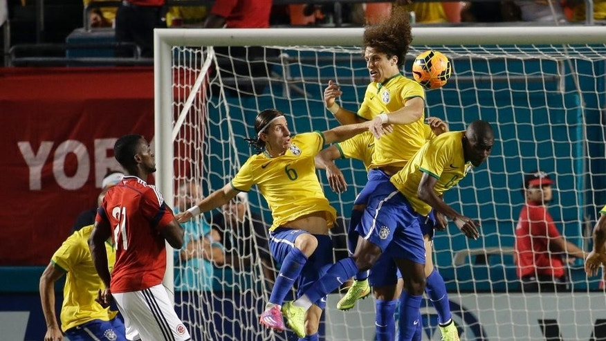 Brazil's Filipe Luis (6), David Luiz, center, and Ramires (8) defend the goal as Colombia's Jackson Martinez (21) watches during the first half of an international friendly soccer match, Friday, Sept. 5, 2014, in Miami Gardens, Fla. (AP Photo/Lynne Sladky)