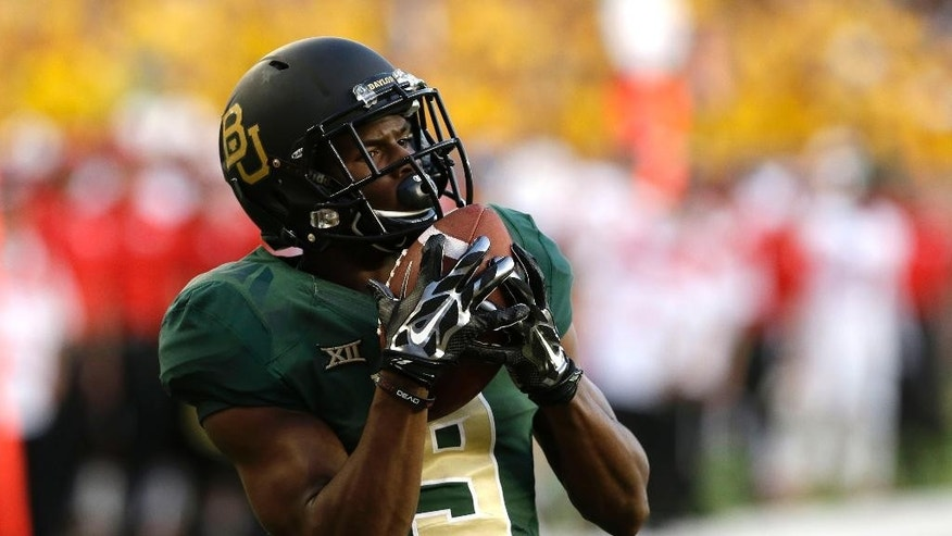 Baylor wide receiver KD Cannon (9) catches a touchdown pass during the first half of an NCAA college football game against SMU Sunday, Aug. 31, 2014, in Waco, Texas. (AP Photo/LM Otero)