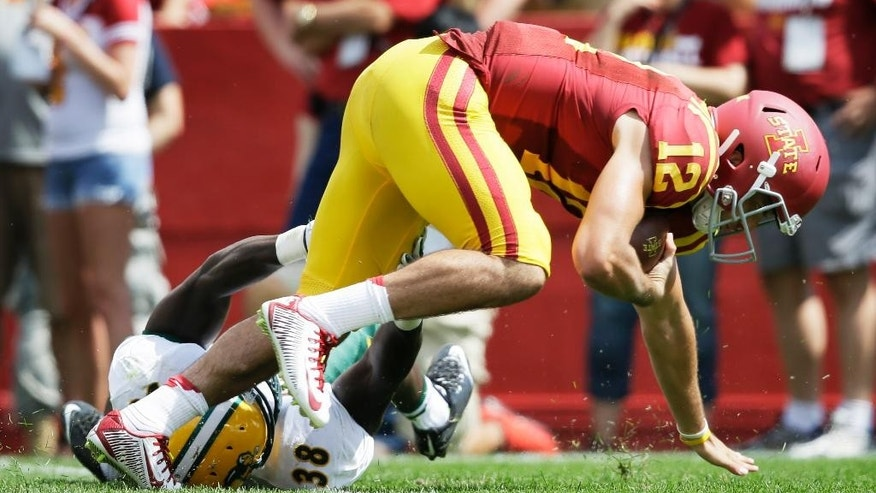 Iowa State quarterback Sam B. Richardson (12) is sacked by North Dakota State linebacker Carlton Littlejohn (38) during the second half of an NCAA college football game, Saturday, Aug. 30, 2014, in Ames, Iowa. North Dakota State won 34-14. (AP Photo/Charlie Neibergall)