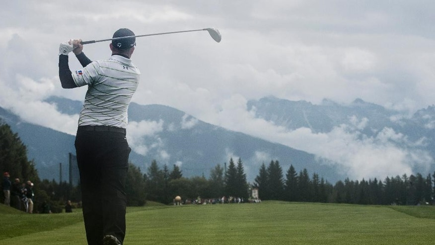 Richie Ramsay of Scottland tees off at hole 7 during the second round of the Omega European Masters Golf Tournament in Crans-Montana, Switzerland, Friday, September 5, 2014. (AP Photo/Keystone/Ennio Leanza)