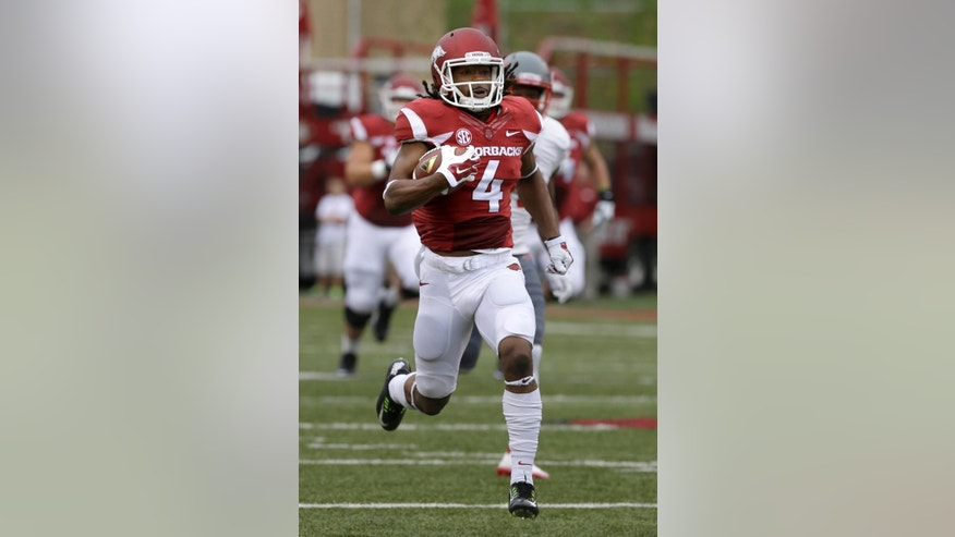 Arkansas wide receiver Keon Hatcher (4) carries to the end zone to score Arkansas' first touchdown in the first quarter of an NCAA college football game against Nichols in Fayetteville, Ark., Saturday, Sept. 6, 2014. (AP Photo/Danny Johnston)