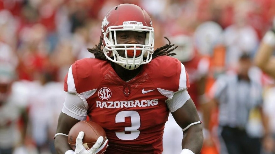 Arkansas running back Alex Collins runs to the end zone to score in the first quarter of an NCAA college football game against Nichols in Fayetteville, Ark., Saturday, Sept. 6, 2014. (AP Photo/Danny Johnston)