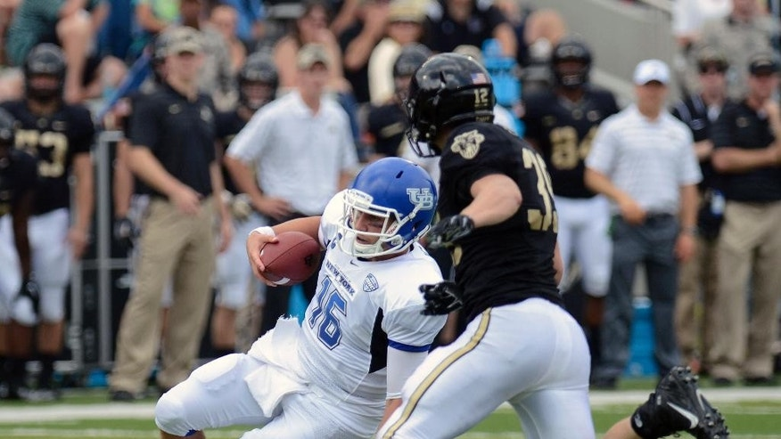 Buffalo quarterback Joe Licata (16) runs the ball while being defended by Army linebacker Jeremy Timpf, right, during the first half of an NCAA college football game Saturday, Sept. 6, 2014, in West Point, N.Y. (AP Photo/Hans Pennink)