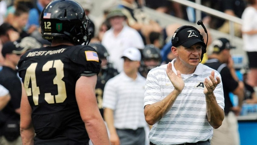 Army head coach Jeff Monken instructs his players during the first half of an NCAA college football game against Buffalo, Saturday, Sept. 6, 2014, in West Point, N.Y. (AP Photo/Hans Pennink)