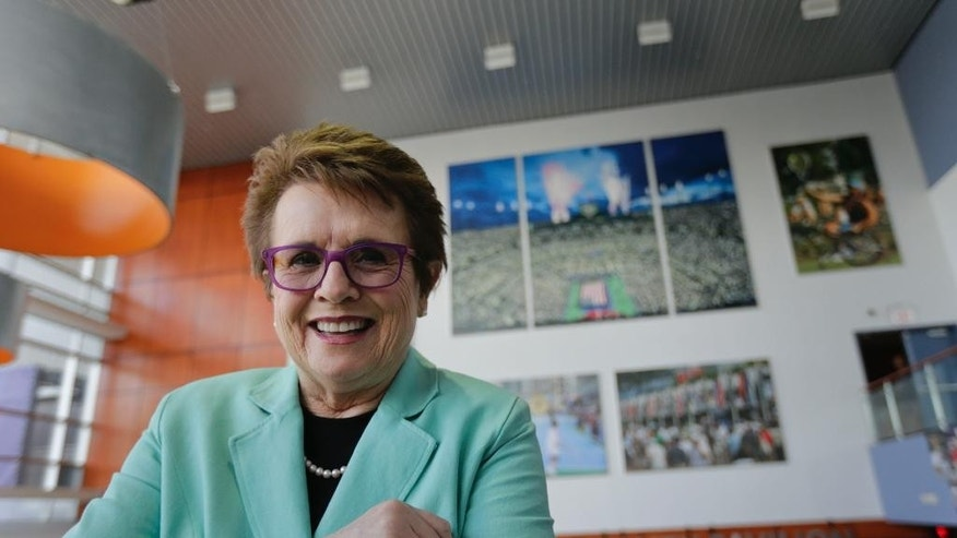 In this photo taken Thursday, Sept. 4, 2014, Billie Jean King poses for a photo inside the hospitality pavilion at the U.S. Open tennis tournament in New York. King is so busy attending events during the tournament, she hardly has time to watch matches at the venue that bears her name. (AP Photo/Charles Krupa)