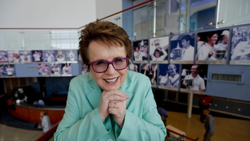 In this photo taken Thursday, Sept. 4, 2014, Billie Jean King poses for a photo inside the indoor practice facility at the U.S. Open tennis tournament in New York. King is so busy attending events during the tournament, she hardly has time to watch matches at the venue that bears her name. (AP Photo/Charles Krupa)