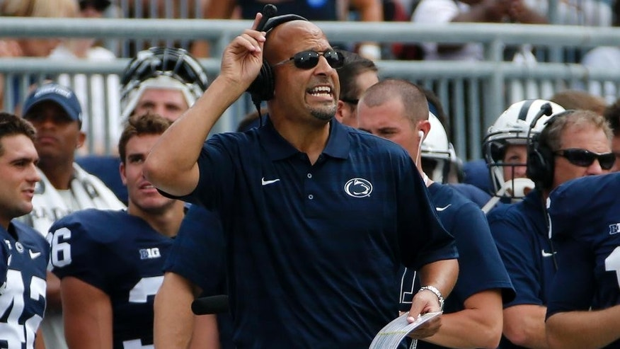 Penn State head coach James Franklin yells instructions from the sidelines during the second quarter of an NCAA college football game against Akron in State College, Pa., Saturday, Sept. 6, 2014. (AP Photo/Gene J. Puskar)