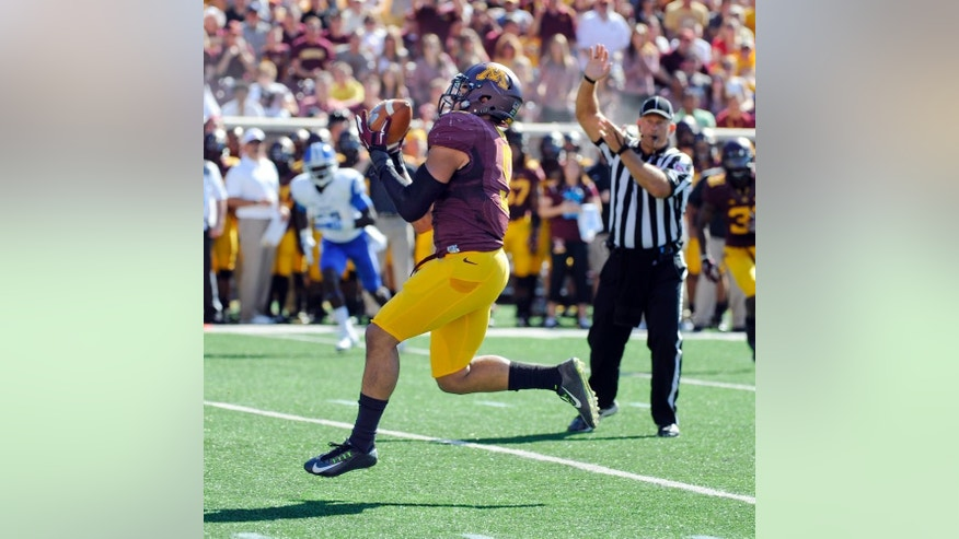 Minnesota linebacker Damien Wilson catches a tipped pass for an interception and returns it for a touchdown against Middle Tennessee during the first half of an NCAA college football game on Saturday, Sept. 6, 2014, in Minneapolis. (AP Photo/Craig Lassig)