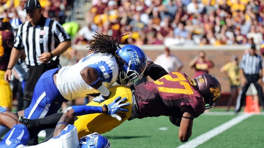 Minnesota running back David Cobb (27) dives into the end zone for a touchdown against Middle Tennessee during the first half of an NCAA college football game on Saturday, Sept. 6, 2014, in Minneapolis. (AP Photo/Craig Lassig)