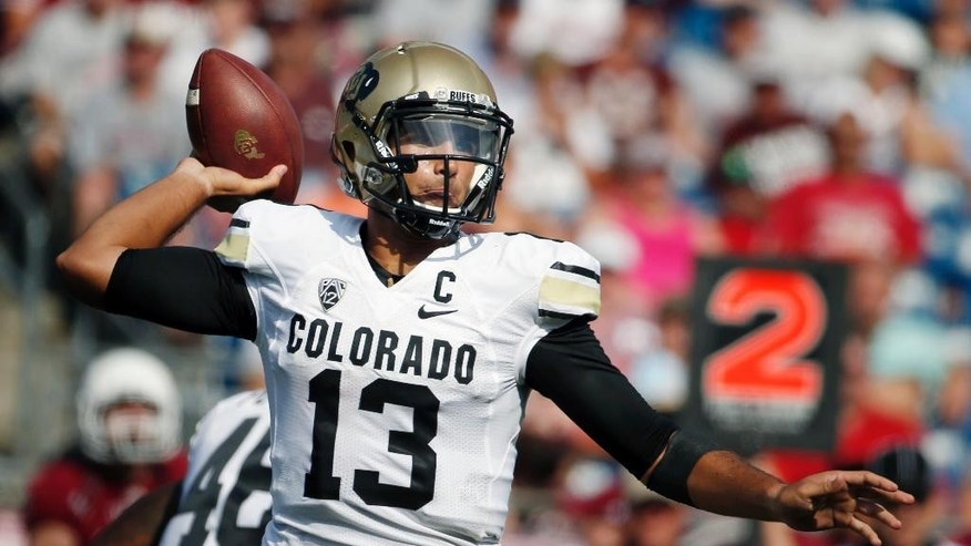 Colorado quarterback Sefo Liufau (13) passes in the first quarter of an NCAA college football game against Massachusetts in Foxborough, Mass., Saturday, Sept. 6, 2014. (AP Photo/Michael Dwyer)