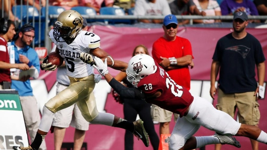Colorado wide receiver Shay Fields (5) breaks tackle on Massachusetts defensive back Jackson Porter (28) on a touchdown reception in the second quarter of an NCAA college football game in Foxborough, Mass., Saturday, Sept. 6, 2014. (AP Photo/Michael Dwyer)
