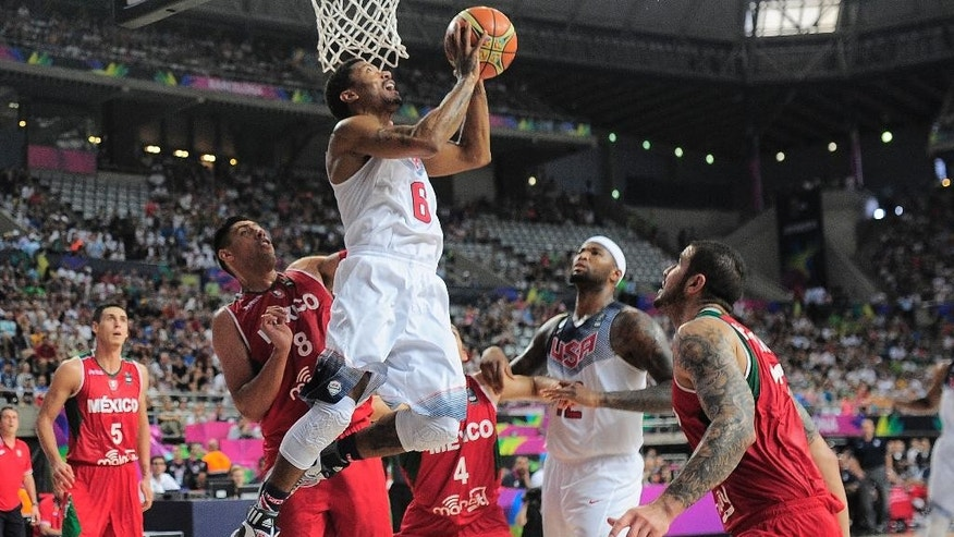 Derrick Rose of the U.S, third left, shoots over Mexico's Gustavo Ayon, second left, during Basketball World Cup Round of 16 match between United States and Mexico at the Palau Sant Jordi in Barcelona, Spain, Saturday, Sept. 6, 2014. The 2014 Basketball World Cup competition will take place in various cities in Spain from Aug. 30 through to Sept. 14. (AP Photo/Manu Fernandez)