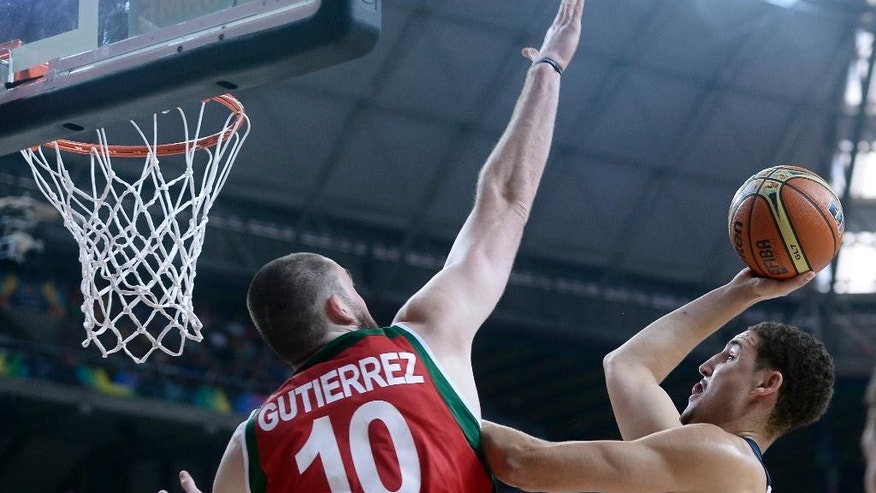 Klay Thompson of the U.S, right, vies for the ball over Mexico's Israel Guitierrez during Basketball World Cup Round of 16 match between United States and Mexico at the Palau Sant Jordi in Barcelona, Spain, Saturday, Sept. 6, 2014. The 2014 Basketball World Cup competition will take place in various cities in Spain from Aug. 30 through to Sept. 14. (AP Photo/Manu Fernandez)