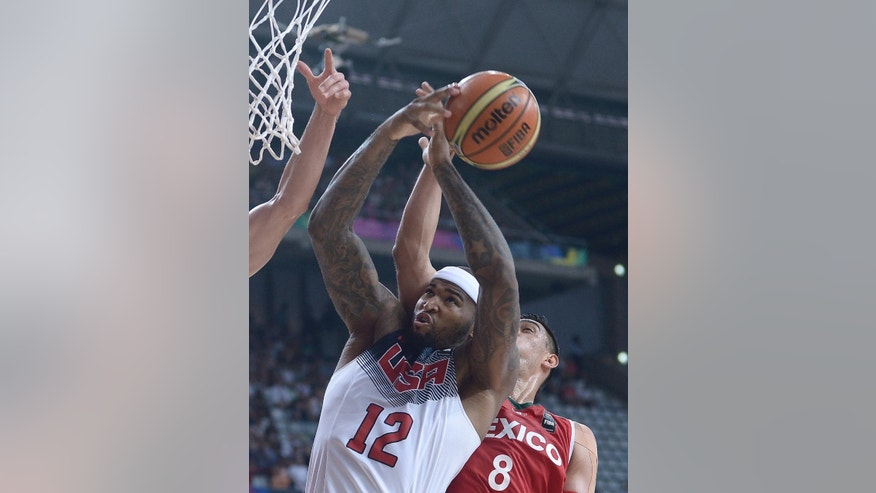 DeMarcus Cousins of the U.S, left, shoots over Mexico's Marco Ramos during Basketball World Cup Round of 16 match between United States and Mexico at the Palau Sant Jordi in Barcelona, Spain, Saturday, Sept. 6, 2014. The 2014 Basketball World Cup competition will take place in various cities in Spain from Aug. 30 through to Sept. 14. (AP Photo/Manu Fernandez)
