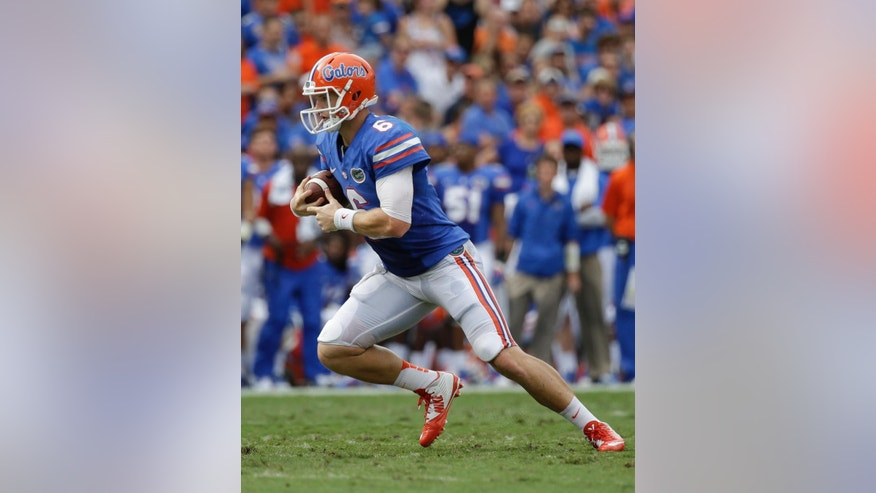 Florida quarterback Jeff Driskel (6) scrambles for yardage against Eastern Michigan during the first half of an NCAA college football game in Gainesville, Fla., Saturday, Sept. 6, 2014. (AP Photo/John Raoux)