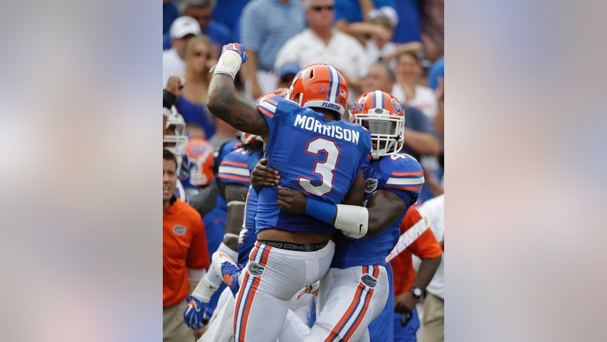 Florida linebacker Antonio Morrison (3) celebrates his fumble recovery against Eastern Michigan as he gets a hug from teammate linebacker Jarrad Davis, right, during the first half of an NCAA college football game in Gainesville, Fla., Saturday, Sept. 6, 2014. (AP Photo/John Raoux)