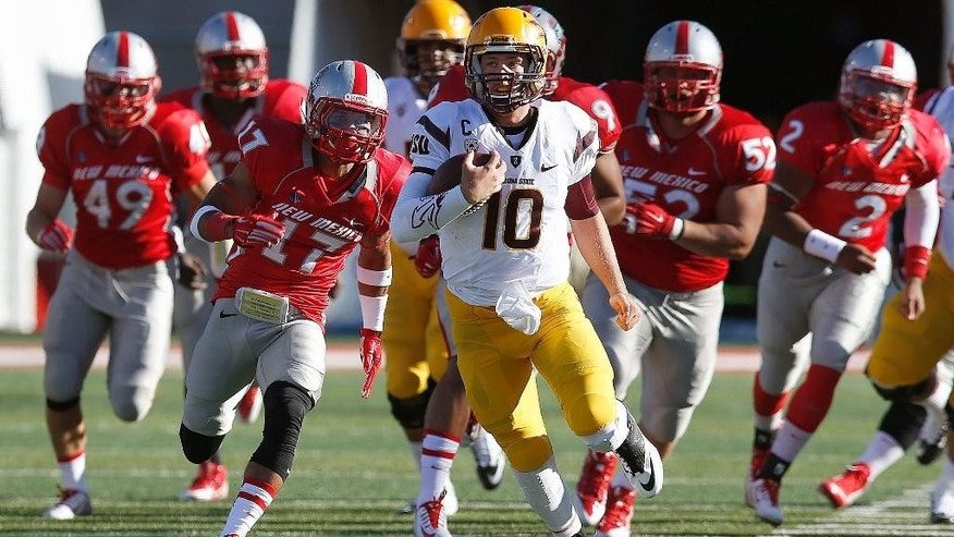 Arizona State's Taylor Kelly (10) runs for a long gain as New Mexico's Dakota Cox (49), Jadon Boatright (17), Cole Juarez (52), and Kimmie Carson (2) all give chase during the first half of an NCAA college football game Saturday, Sept. 6, 2014, in Albuquerque, N.M. (AP Photo/Ross D. Franklin)