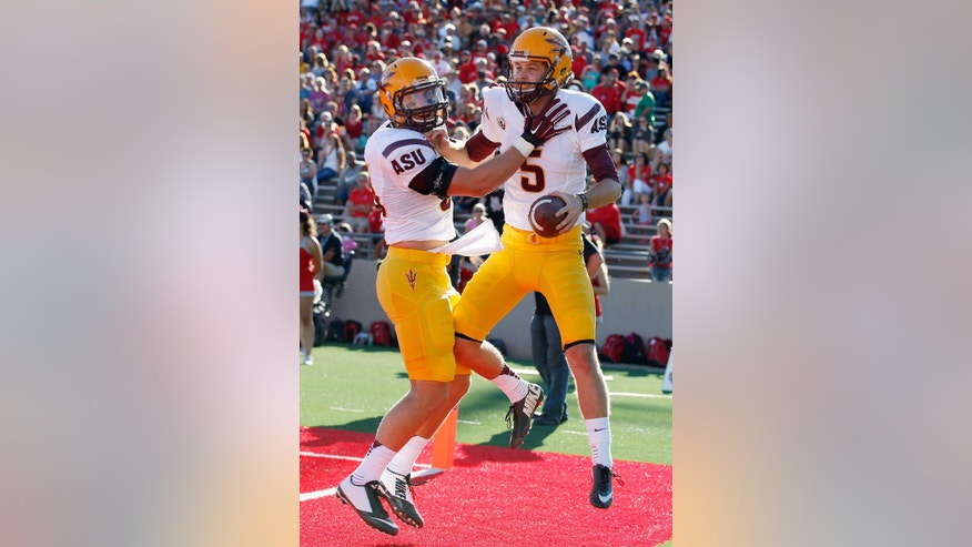 Arizona State's Zane Gonzalez (5) celebrates his 2-point conversion catch against New Mexico with teammate Kody Kohl during the first half of an NCAA college football game Saturday, Sept. 6, 2014, in Albuquerque, N.M. (AP Photo/Ross D. Franklin)