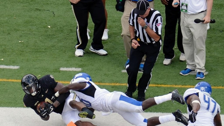Army fullback Raymond Maples (1) scores against Buffalo while being defended by Trenton Turrentine during the first half of an NCAA college football game on Saturday, Sept. 6, 2014, in West Point, N.Y. (AP Photo/Hans Pennink)