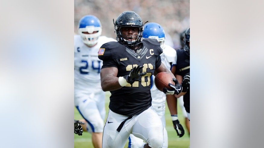 Army running back Larry Dixon (26) runs for a touchdown against Buffalo during the first half of an NCAA college football game Saturday, Sept. 6, 2014, in West Point, N.Y. (AP Photo/Hans Pennink)