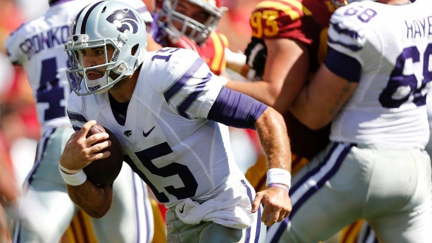 Kansas State quarterback Jake Waters (15) rushes into the end zone for the game-winning touchdown during the second half of an NCAA college football game against Iowa State, Saturday, Sept. 6, 2014, in Ames, Iowa. Kansas State won 32-28. (AP Photo/Justin Hayworth)