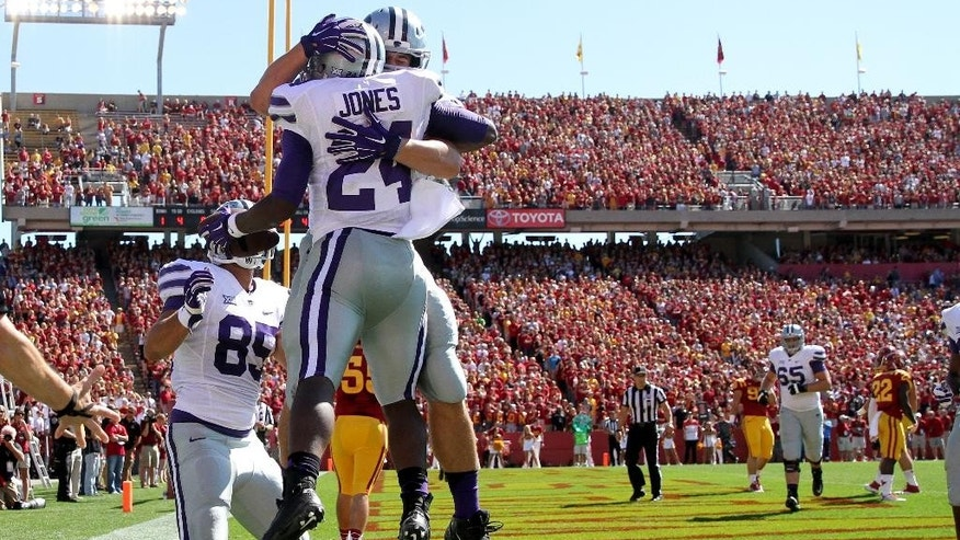 Kansas State fullback Glenn Gronkowski (48) and Charles Jones (24) celebrate a touchdown run by Jones during the first half of an NCAA college football game against Iowa State Saturday, Sept. 6, 2014, in Ames, Iowa. Kansas State won 32-28. (AP Photo/Justin Hayworth)