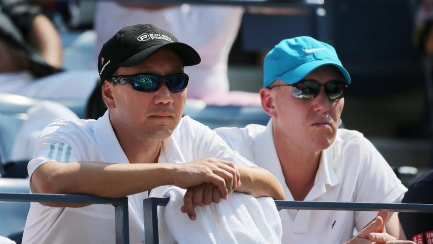 Michael Chang, left, coach of Kei Nishikori, of Japan, watches play between Nishikori and Novak Djokovic, of Serbia, during the semifinals of the 2014 U.S. Open tennis tournament, Saturday, Sept. 6, 2014, in New York. (AP Photo/Mike Groll)