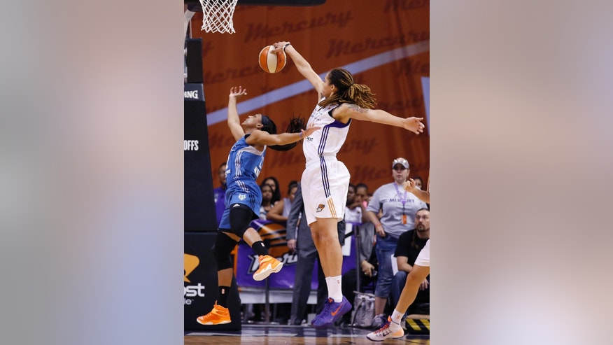 Phoenix Mercury's Brittney Griner, right, blocks the shot of Minnesota Lynx's Monica Wright during the second half of Game 3 in the WNBA Western Conference basketball finals Tuesday, Sept. 2, 2014, in Phoenix. The Mercury defeated the Lynx 96-78, winning the series and advancing to the WNBA Finals. (AP Photo/Ross D. Franklin)