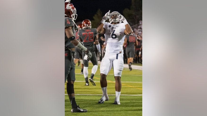 Nevada's Don Jackson (6) celebrates after scoring against Washington State during the first half of an NCAA college football game Friday, Sept. 5, 2014, in Reno, Nev. (AP Photo/Kevin Clifford)