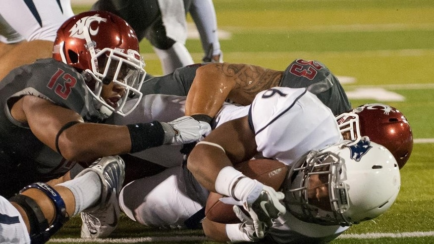 Nevada's Don Jackson (6) scores after getting past Washington State's Darryl Monroe (13) and Tana Pritchard during the first half of an NCAA college football game Friday, Sept. 5, 2014 in Reno, Nev. (AP Photo/Kevin Clifford)