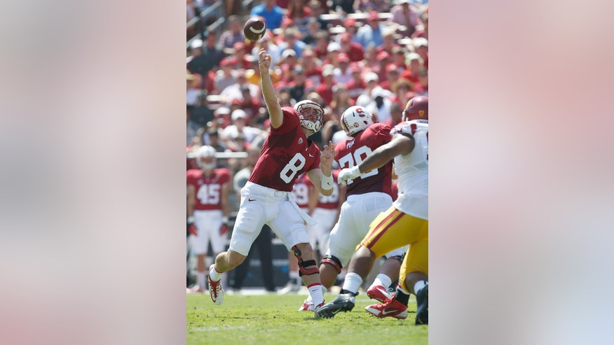 Stanford quarterback Kevin Hogan (8) throws against Southern California during the first half of an NCAA college football game on Saturday, Sept. 6, 2014, in Stanford, Calif. (AP Photo/Tony Avelar)