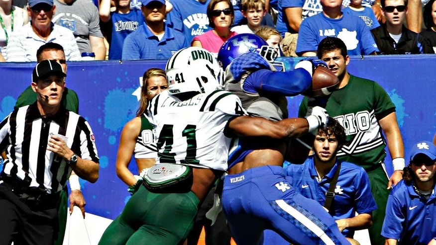 Kentucky wide receiver Dorian Baker, right, makes at catch in front of Ohio defender Ian Wells (41) at the goal line that was ruled a 8-yard touchdown completion in the first half of their NCAA college football game in Lexington, Ky., Saturday Sept. 6, 2014. (AP Photo/Garry Jones)