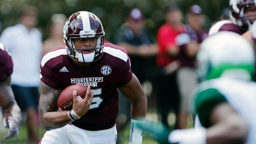 Mississippi State quarterback Dak Prescott (15) runs in the first quarter of an NCAA college football game against UAB at Davis Wade Stadium in Starkville, Miss., Saturday, Sept. 6, 2014.  (AP Photo/Rogelio V. Solis)