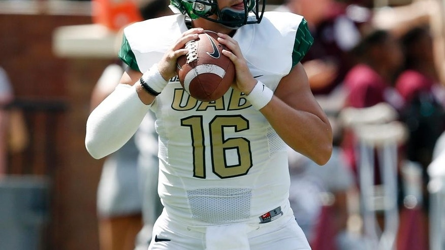 UAB quarterback Jeremiah Briscoe (16) sets up for a pass against Mississippi State in the first half of an NCAA college football game in Starkville, Miss., Saturday, Sept. 6, 2014.  (AP Photo/Rogelio V. Solis)