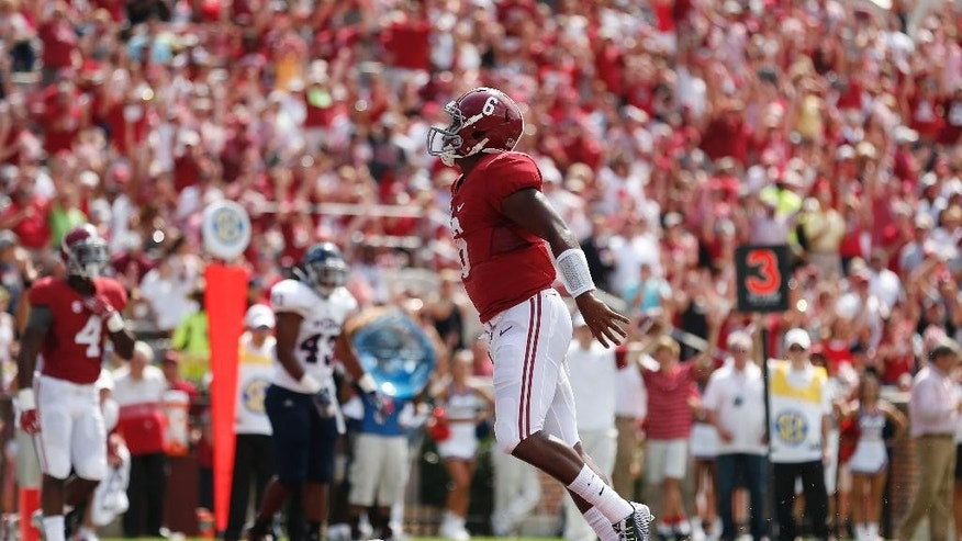 Alabama quarterback Blake Sims (6) scores in the first half against Florida Atlantic during an NCAA college football game Saturday, Sept. 6, 2014, in Tuscaloosa, Ala. (AP Photo/Brynn Anderson)