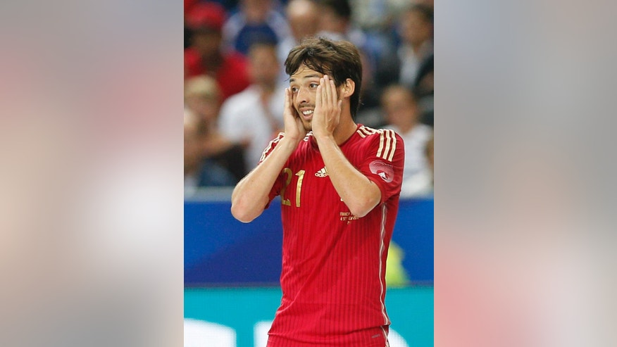 Spain's David Silva reacts after missing a goal against France during their international friendly soccer match at the Stade de France in Saint Denis, outside Paris, Thursday Sept. 4, 2014. (AP Photo/Christophe Ena)