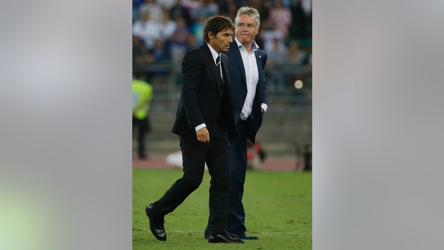 Italy coach Antonio Conte, left, walks past Netherlands coach Guus Hiddink at the end of a friendly soccer match between Italy and The Netherlands in Bari, Italy, Thursday, Sept. 4, 2014. Italy won 2 - 0. (AP Photo/Gregorio Borgia)