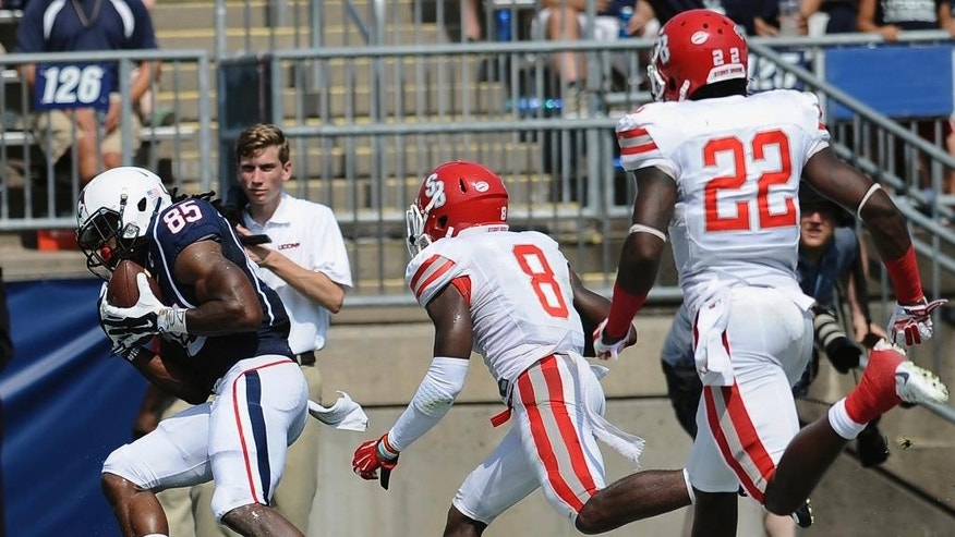 Connecticut wide receiver Geremy Davis (85) pulls in a pass for a touchdown in the end zone as Stony Brook's Jaheem Woods (8), and Naim Cheeseboro (22) look on during the first half of an NCAA college football game at Rentschler Field, Saturday, Sept. 6, 2014, in East Hartford, Conn. (AP Photo/Jessica Hill)