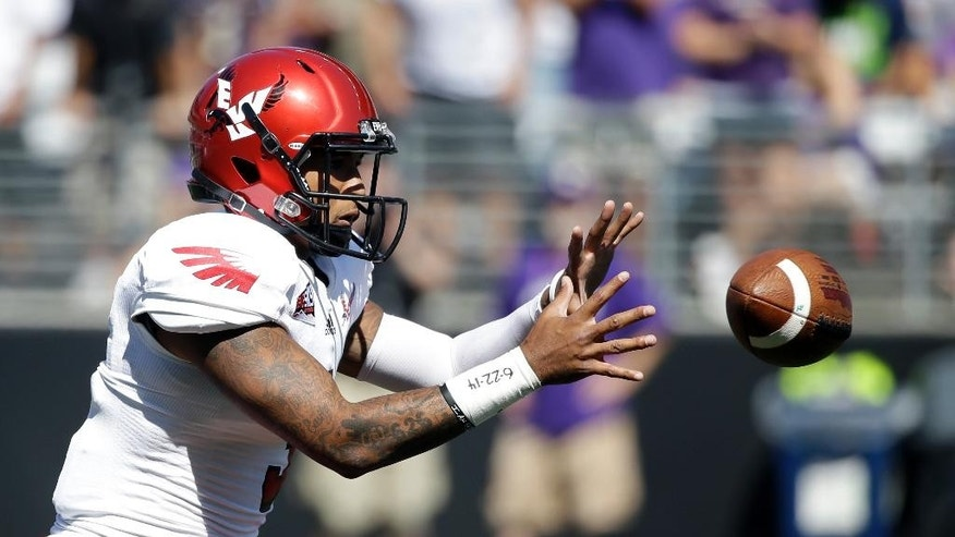 Eastern Washington quarterback Vernon Adams Jr. takes a snap against Washington in the first half of an NCAA football game Saturday, Sept. 6, 2014, in Seattle. (AP Photo/Elaine Thompson)