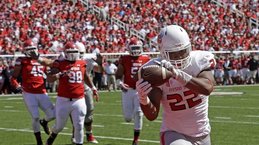 Fresno State running back Malique Micenheimer (22) catches a touch down pass in the second quarter during an NCAA college football game against Utah Saturday, Sept. 6, 2014, in Salt Lake City.  (AP Photo/Rick Bowmer)