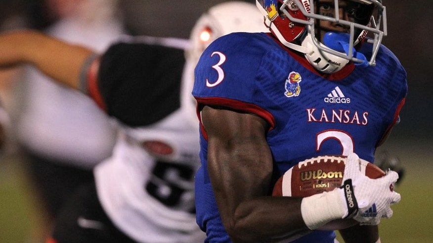 Kansas wide receiver Tony Pierson runs for a 67-yard touchdown pass against Southeast Missouri State during the third quarter of an NCAA football game Saturday, Sept. 6, 2014, in Lawrence, Kan. Kansas won 34-28. (AP Photo/Ed Zurga)