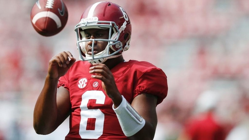 Alabama quarterback Blake Sims (6) catches the ball during warmups before the first half of an NCAA college football game against Florida Atlantic Saturday, Sept. 6, 2014, in Tuscaloosa, Ala. (AP Photo/Brynn Anderson)