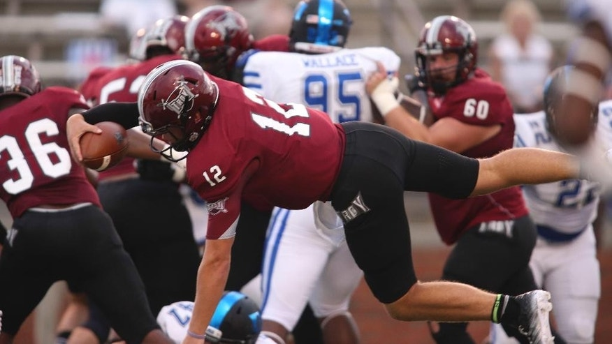 Troy quarterback Brandon Silvers (12) dives in for a touchdown in the first half of an NCAA college football game against Duke at Veterans Memorial Stadium, Saturday, Sept. 6, 2014, in Troy, Ala. (AP Photo/ Hal Yeager)